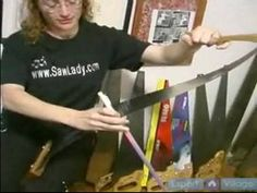 How to Play the Musical Saw : Using the Bow on a Musical Saw