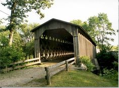 The Old Cedarburg Bridge, built in 1876, located three miles north of the City of Cedarburg and 20 miles north of Milwaukee near the junction of Highways 60 and 143 on the Covered Bridge Road.