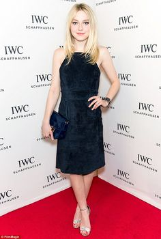 Beautiful in blue: Dakota Fanning looked stylish in a velvet navy frock as she arrived for...