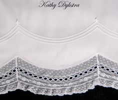 Heirloom Pillowcase - this 9 hour class will allow students to become comfortable sewing with laces, shaping lace, making pintucks and stitching the lace to the pillowcase with a corded pintuck to mimic entredeux.