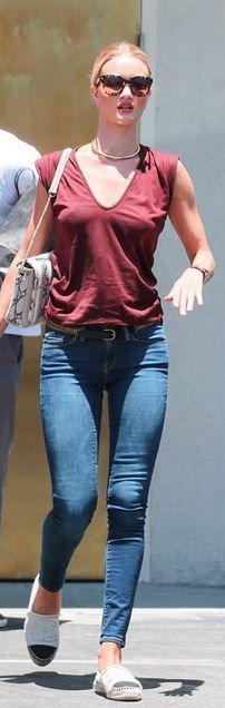 Rosie Huntington-Whiteley: Purse – Salvatore Ferragamo Bracelet – Cartier Earrings – Anita Jeans – Frame Shirt and belt – Isabel Marant watch – Rolex