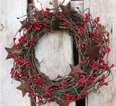 grape vine wreath with red berries