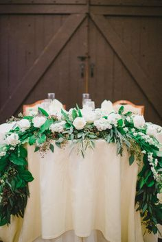 Gorgeous garland: http://www.stylemepretty.com/little-black-book-blog/2015/01/23/romantic-military-wedding-at-villanova-university/ | Photography: Rachel Pearlman - http://www.rachelpearlmanphotography.com/