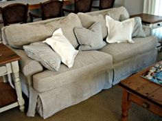 Sofa with washable, oatmeal natural linen custom slipcovers.