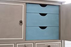 The inside of an armoire beautifully finished in French Linen & Old White Chalk Paint® decorative paint by Annie Sloan. The inside was give a pop of color with a custom blend of Aubusson Blue & Louis Blue Chalk Paint® | By Finding Silver Pennies