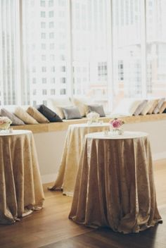 Reception cocktail tables with silk draped cloths | photography by http://www.lovetheschultzes.com