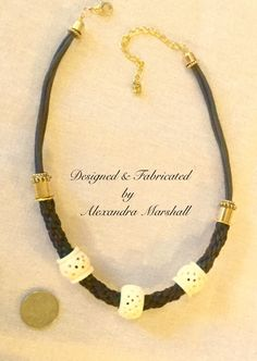 """This brown and ivory kumihimo braided linen cord necklace with brass embellishment & giant hand carved African bone boules by Alexandra Marshall could be your most elegant casual statement piece. 18"""" long w/3"""" extender chain. $79. #N2355. Double click photo to order."""