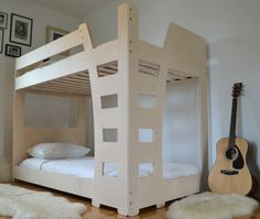 Paris inspired bunk bed design ********************************************************************************** Excellent minimalistic design with a Double Corner entrance to both beds!  ********************************************************************************** This bunk bed is made to hold standard twin sized mattresses 74 3/8 x 38 1/4 with a thickness of between 6-8on the top bunk. Bunk bed dimensions: 77 L x 41 W x 59 H Made completely out of birch multiply, sanded to a smooth…