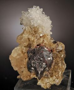 Cinnabar (twinned crystals on Quartz and Calcite) stock #6.2-640 Yanwuping Mine, Wanshan, Tongren Guizoh, China 5.3 x 3.8 CM (small cabinet/ large miniature) price: $290 Tucson group Well Arranged Molecules