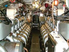 Submarine interior.  Engine Room - one of two.  Diesels shown are either of German design or General Motors.  The German engines were not reliable, so the navy started switching to Fairbanks Morse diesels.