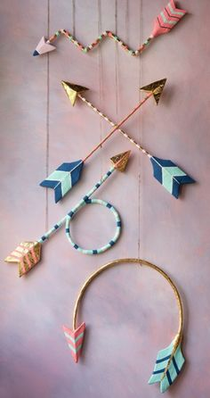 """Bring some """"WOW!"""" to your little one's nursery with these boho hand-painted wall arrows. Each arrow will add the perfect amount of whimsy! Hand-painted, gold leafed and ready to hang, in your savvy boho baby's room. Arrow Feather, Arrow Art, Arrow Decor, Dream Catcher Boho, Dream Catchers, Boho Diy, Bohemian, Wood Necklace, Tiny Treasures"""