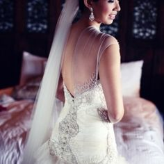 This classy and sophisticated wedding dress is all wrapped up in glamour -so delicious!