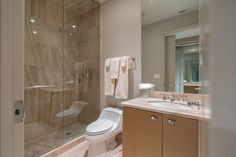 Contemporary 3/4 Bathroom with Custom Mirrors, Travertine counters, specialty tile floors, Flush, Italian Cream, Marble