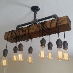 Industrial Rustic Wood Beam Plumbing Pipe Hanging Exposed Bulb Metal Island Pendant Light – Pendant Lights – Ceiling Lights – Lighting - All For Decoration Linear Pendant Lighting, Island Pendant Lights, Light Pendant, Kitchen Pendant Lighting, Vintage Industrial Lighting, Rustic Lighting, Rustic Pool Table Lights, Industrial Bathroom Lighting, Kitchen Lighting Over Table