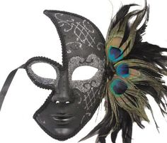 RedSkyTrader - Black Venetian Mask with Silver Sparkles and Peacock Feathers - One Size fits Most - Black and Silver RedSkyTrader, http://www.amazon.com/dp/B006091HIO/ref=cm_sw_r_pi_dp_-hrBqb14CK5N2