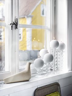 display: vitra bourellec l'oiseau and iittala festivo candleholders