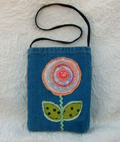 Silly little upcycled denim purse. $12.00, via Etsy.