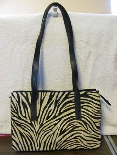 This stylish bag from IBD is the perfect blend of fashion and function    This bag hits all the style notes    This bag is a must have    IBD    ITALIAN BAGS DIRECTORY    WOMENS LEATHER    FAUX ZEBRA    SATCHEL/SHOULDER HANDBAG    BLACK LINING    ZIPPERED CLOSURE    1 COMPARTMENTS    1 ZIPPERED POCKET    MINT CONDITION    FOR PREOWNED    8 IN HEIGHT    12 IN LENGTH    7.5 IN DEEP    12 IN STRAP DROP    AWESOME HANDBAG    SUPER CUTE    WONDERFUL ADDITION    TO YOUR WARDROBE