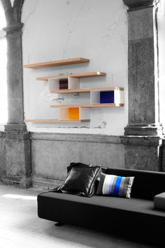 """Contrast Shelving by Studio Segers - A modular shelving system with """"sober finishes and colourful upholstered back wall sections for contrast."""" """"Colorfull but small upholstered back walls in combination with sober lacquered elements give this collection a unique look and feel."""" 