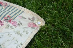 picnic quilt- put a gromet in each corner of the quilt and insert a golf tee to keep the quilt from blowing off the ground.