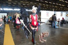 Beautiful Raiment of the Lich cosplay, complete with minion puppet!