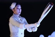 Kim Yu-na, South Korean Figure Skater lights the cauldron during the Opening Ceremony of the PyeongChang 2018 Winter Olympic Games at PyeongChang Olympic Stadium on February 2018 in Pyeongchang-gun, South Korea Kim Yuna, 2018 Winter Olympic Games, Winter Games, Olympics Opening Ceremony, Pyeongchang 2018 Winter Olympics, Johnny Weir, Medvedeva, Olympic Athletes, Figure Skating