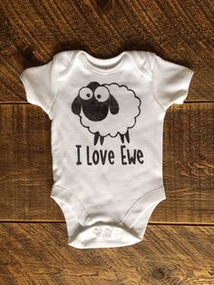 A personal favourite from my Etsy shop https://www.etsy.com/uk/listing/514603220/sheep-i-love-ewe-onsie-vest-babygrow