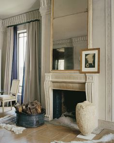 <strong>FEW BUT FINE</strong> Stephen Sills's diminutive penthouse, with a Louis XVI chair, an Italian Directoire mirror, a Man Ray photograph and a Classical period Greek urn.