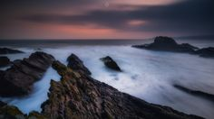 All Consumed - A long exposure, landscape image of rocks on the shores of Cullen Bay in Morayshire, Scotland, at sunrise.