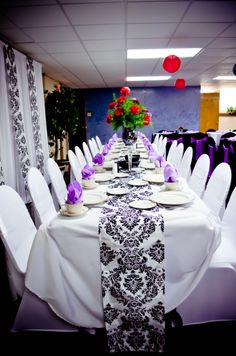 Event: Black & White Spandex Chair Covers, Purple Satin Sashes, White Polyester Tablecloths, Damask Table Runners, Purple Mirrored Vases, & Lavender Napkins