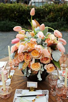 arrangement with peach roses and tulips