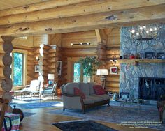 Living room in handcrafted waterfront home I designed in Michigan about fifteen years ago.  #logcabins #loghomes #logcabindesign #loghomedesign