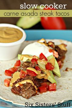 Slow Cooker Carne Asada Steak Tacos on SixSistersStuff.com - this meat just falls apart after cooking all day!