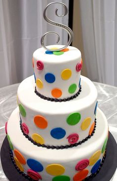 3 level white round wedding cake with pokadots and silver monogram topper.JPG