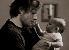 Ed Sheeran with a baby. Thai is photoshopped, but I love it a lot.