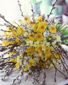 Kelsey --- LOVE the pussywillows tucked into this arrangement, only green and orange and white flowers.