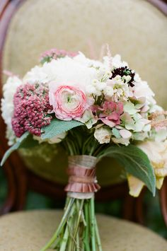 wedding bouquet in muted pink tones and cream