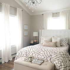 bedroom with soft patterned walls and wood floors...