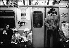 Volunteer Santa on Subway  ~1976  By Susan Meiselas