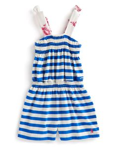 Joules JNR CLEMMIE Girls Jersey all-in-one Playsuit, Seablue. Perfect to wear with an ice cream in one hand and a bucket and spade in the other, this soft cotton all-in-one is a must for a trip to the beach.