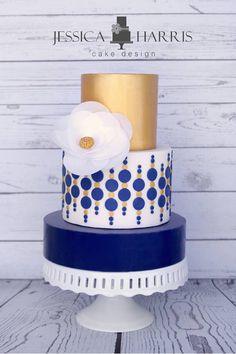 Graphic gold & dark blue tiered cylinder cake by Jessica Harris Cake Design