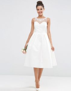 ASOS BRIDAL Crystal Sweetheart Midi Prom Dress (£150).  Super sweet and delightfully delicious prom style wedding dress.  We're loving the sweetheart neckline with sheer high neck and the understated belt is cute as a button.  The shoes work well with the understated elegance of this gown.
