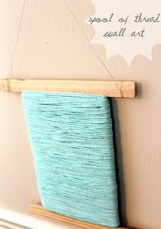 DIY Paint Stick Wall Art Project | Spool Thread Wall Art by DIY Ready at http://diyready.com/paint-stick-diy-projects/