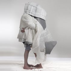 """""""This wearable cocoon of quilts and blankets by Slovakian architecture graduate Danica Pistekova is just right for people who wish they could take their bed with them in the morning."""" Even more absurd than a Snuggie!"""