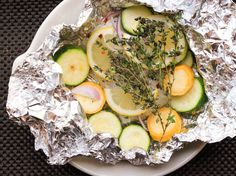 This easy dish of cod cooked in foil packets with squash and fresh herbs is one of the easiest recipes to scale: it works the same whether you make it for one, two, three, four or fourteen people.\n