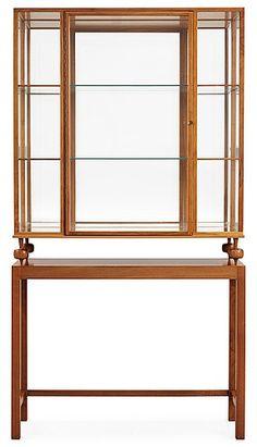 A Josef Frank walnut show case cabinet on stand, model 2077, by Svenskt Tenn. Height 169, width 90, depth 3.... - Spring Modern Auction, Stockholm 566 – Bukowskis