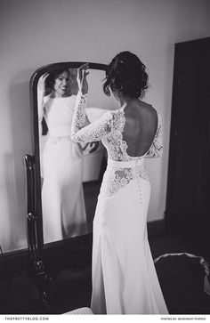 Long wedding dress with open back and lace sleeves and buttons at the back | Dearheart Photos