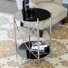 "The polished stainless steel frame has slender, tapering legs with tiered ball finials and gracefully bowed ""X"" stretchers. Top and shelf are black glass.  Overall: 27 1/2""H X 19 1/2""W X 19 1/2""D  $152 + ship  Renard Side Table"
