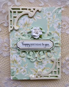 Card by Vickie Blakeslee. Anna Griffin card kit base & sentiment tile, Cuttlebug dies used for corners & center flourish.