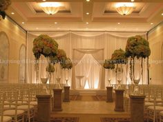 This traditional Chuppah is beautifully complemented by the backdrop and flower pedestals.